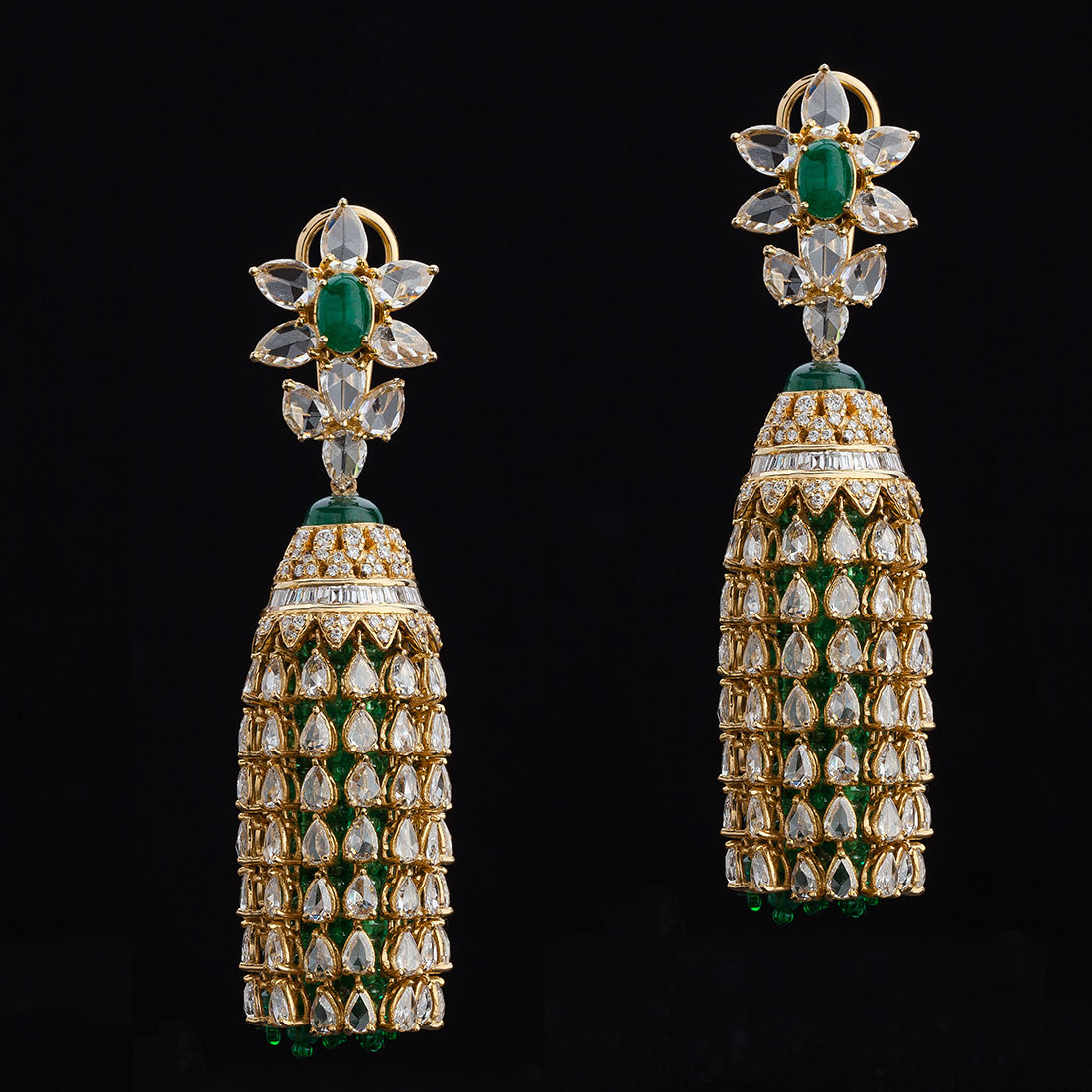 Dare to be different with these unique Emerald Bead and Rosecut Jhumkis set in yellow gold.
